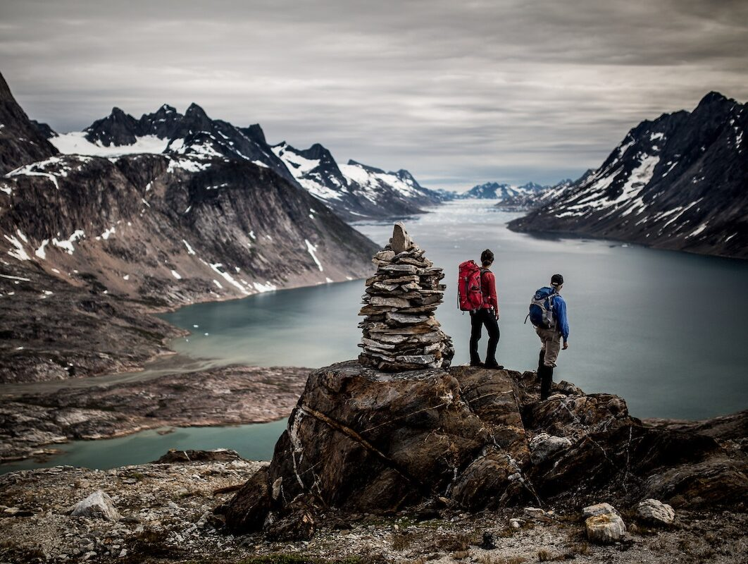 two-hikers-overlooking-the-sound-near-tiniteqilaaq-in-east-greenland